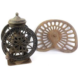 Collection of 2 includes cast iron coffee grinder showing fair condition and antique Deering cast ir
