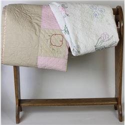 Collection of 2 vintage quilts both good to very good, includes oak quilt stand.