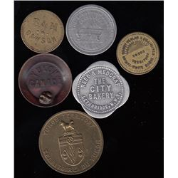 YUKON TERRITORY & NORTHWEST TERRITORIES TOKENS - Lot of 6 tokens.