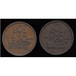 Lot of 2 trade tokens.