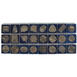 Alan Bean's Collection of (24) ISS Robbins Medals
