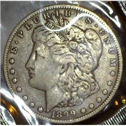 1899 O U.S. Morgan Silver Dollar in a Littleton Coin Company holder, Fine.