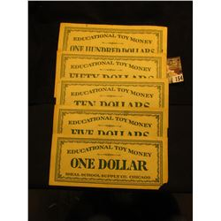 """5 different pieces of """"Educational Toy Money Ideal School Supply Co. Chicago"""" Scrip."""