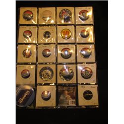 (19) Political Pin-backs and etc. in a plastic coin page.