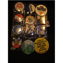 (12) Large Political Pin-backs & etc. in a plastic page.