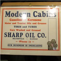 "Sign ""Modern Cabins Gasoline-Kerosene Motor and Tractor Oils and Greases Tires and Tubes Cars Washed"