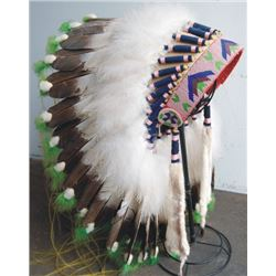 "nicely done 60""s era headdress, believed to be worn by Martina Marshall of Bend, in the movies"