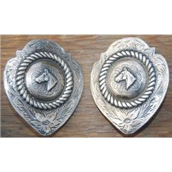 2 shield style silver horsehead conchos