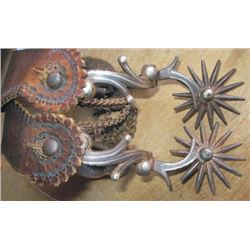 silver inlaid Tapia Style spurs with early straps