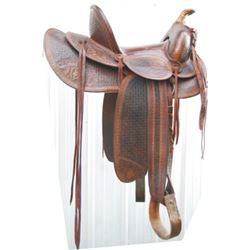 beautiful full tooled early high back saddle