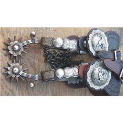 silver inlaid Calif spurs, chased on the off side