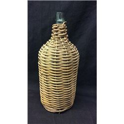 Early Glass Jug Wrapped On Wicker