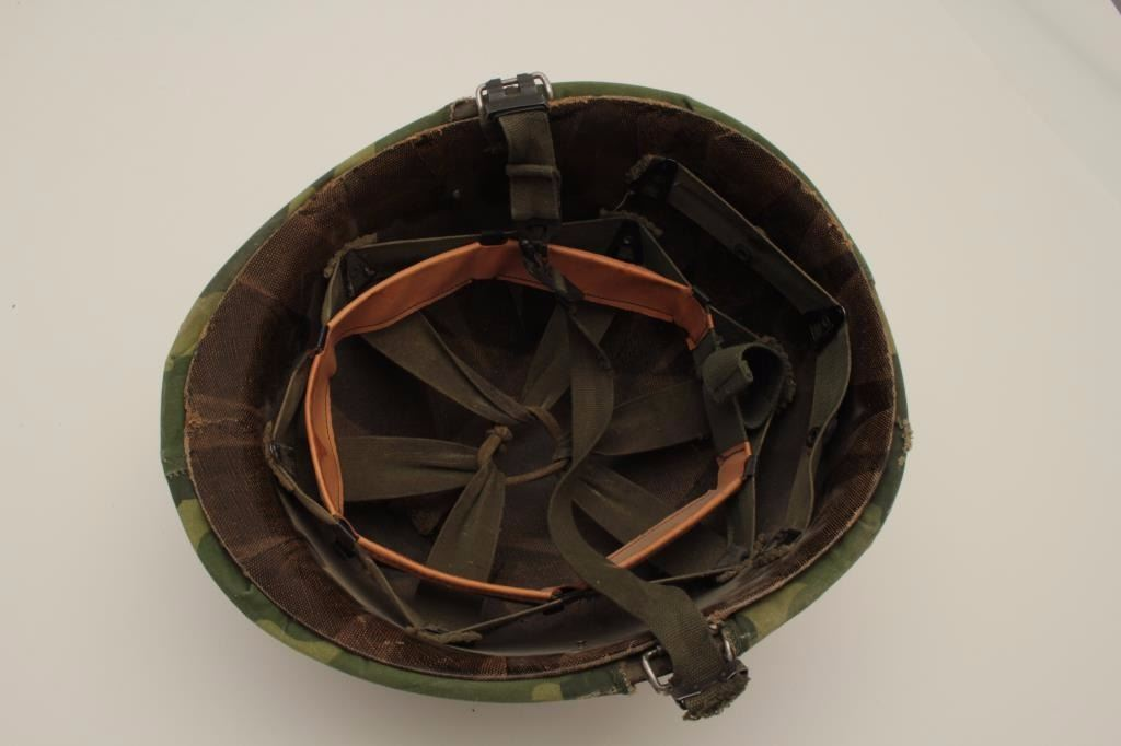 Korean War era helmet with liner, cover and chin strap, in