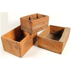 Three Hercules powder boxes