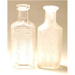 Two Different Phoenix Drug Bottles