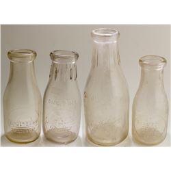 Four Tucson Embossed Milk Bottles