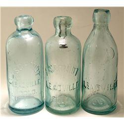 Three Different Schmidt Soda Bottles