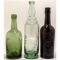 Three Foreign Pictorial Bottles
