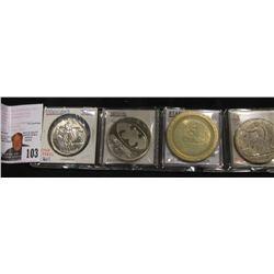 "Magician's Token; ""Batgirl"" Proof Medallion; $5 Stardust Gaming Medal, & a counterfeit Trade Dollar."