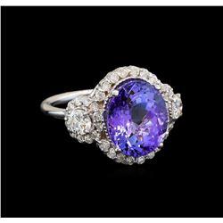 14KT White Gold 6.14 ctw Tanzanite and Diamond Ring