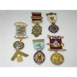 Five Masonic medals including: a 9ct gold and polychrome enamel