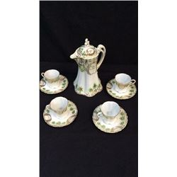Hand Painted Nippon Tea Set Tea pot, four cups and saucers with each cup.  Small hairline crack in o