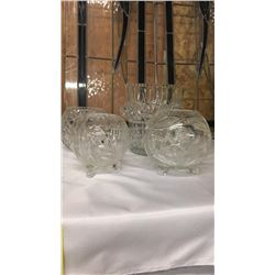 Collection Of Four Crystal Pieces 3 footed vases one vase with handles