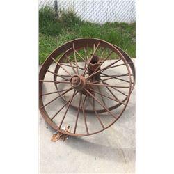 Pair of large iron wheels