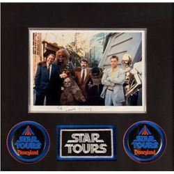 """Star Tours"" Photo Signed by George Lucas."