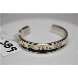 """Tiffany & Co. Sterling Silver Bangle Bracelet 2 1/2"""" X 1/2"""" Wide, From 1837 Collection, Triangle Tap"""
