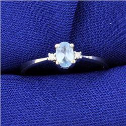 Blue Topaz and Diamond Ring