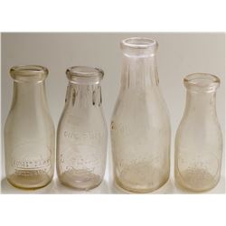 Four Tucson Embossed Milk Bottles