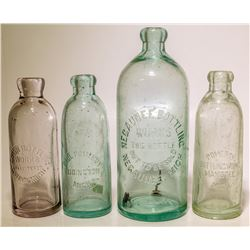 Four different Michigan Hutch soda bottles.