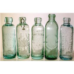 Five different Ontario Hutch soda bottles