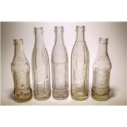 Five Western Soda Bottles