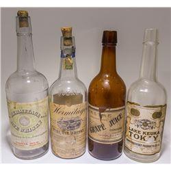 Four Full Face Labeled Whiskey Bottles