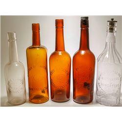 Five Western Whiskey Bottles