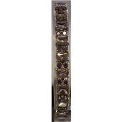 Fancy Sterling Silver Lab Tanzanite Bracelet. (68B)