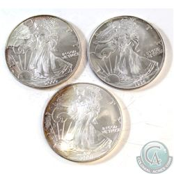 3x USA 1oz .999 Fine Silver Eagles Dated 1994, 2000 & 2001 (Coins are toned). 3pcs (TAX Exempt)