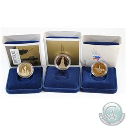 1992 Parliament, 1994 War Memorial, and 1995 Peacekeeping Commemorative Proof Dollars. Coins come en