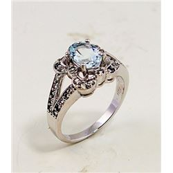 SILVER RING WITH AQUAMARINE AND WHITE ZIRCON