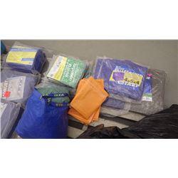 14 unused various sizes of tarps plus 2 bags of used tarps