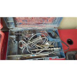 Makita model HR2435 hammer drill with bits