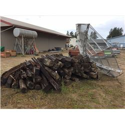 Pile of Misc salvage railway ties and large satellite dish