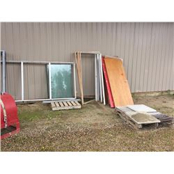 Variety of doors, frames, windows, window frames, and 3 pallets of scrap iron
