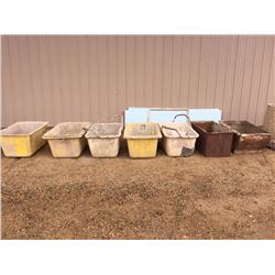 Seven used plastic and metal mortar tubs and two exposed aggregate concrete ash trays