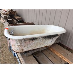 Antique cast iron claw foot bath tub
