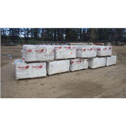 Nine pallets new white split faced block
