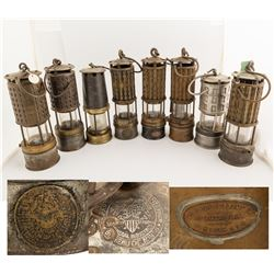 Eight Mining Safety Lamps