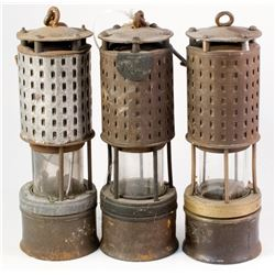 Six Nearly Identical Safety Lamps
